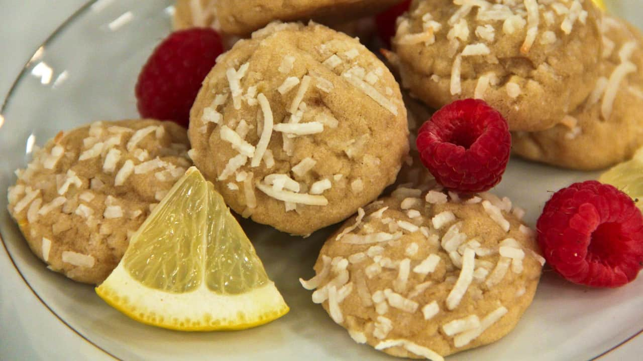 lemon cookies with coconut shreds on a plate