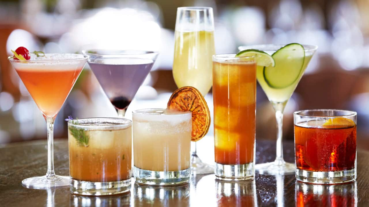 an arrangement of different cocktail drinks