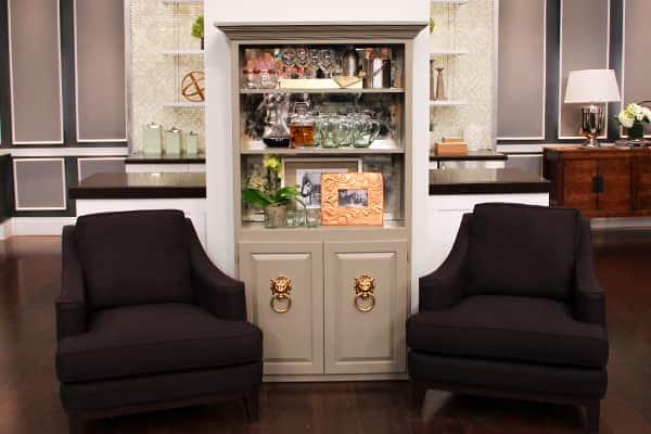 Bookshelf converted into a bar with DIY antique-mirror backsplash.