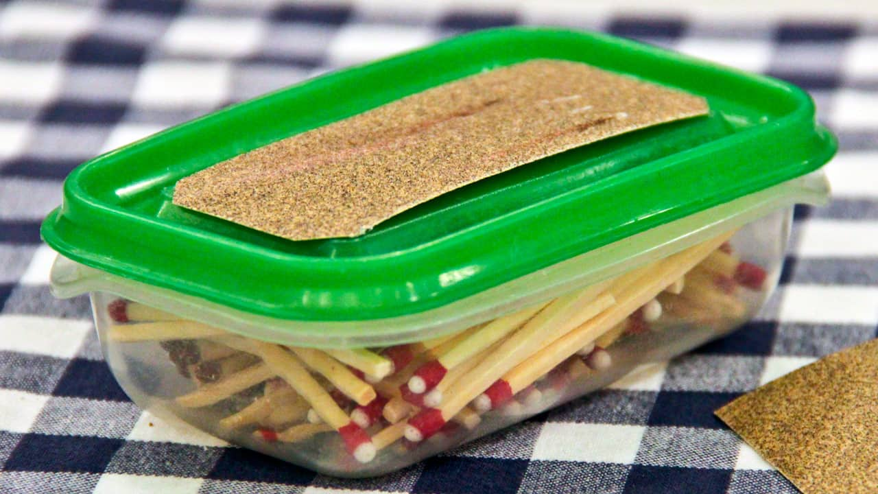 Matches in a plastic container.