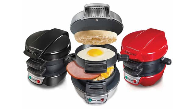 Chris' Angels tested out the Hamilton Beach Breakfast Sandwich Maker. Pictured are three sandwich makers: one in black, one in stainless steel, and one in red.