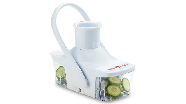 A Slice-O-Matic is slicing cucumbers into circles.