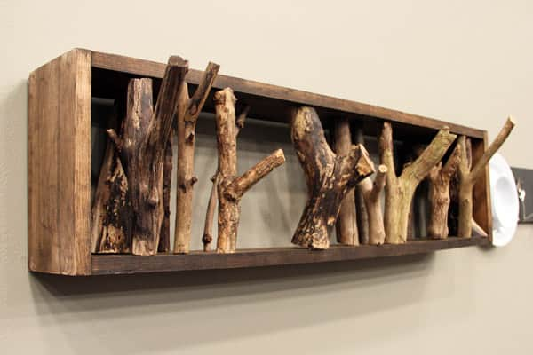 DIY coat rack made from wood branches.