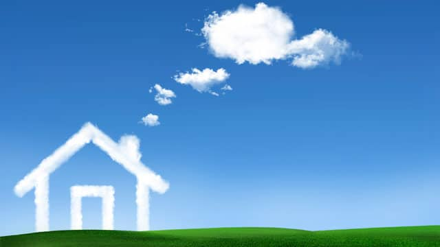 An outline of a house is made with clouds in a clear blue sky.