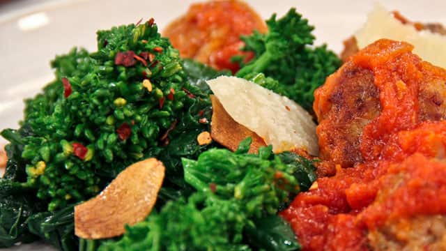 Rapini with garlic, chili and lemon is served as a side dish to Chef ...