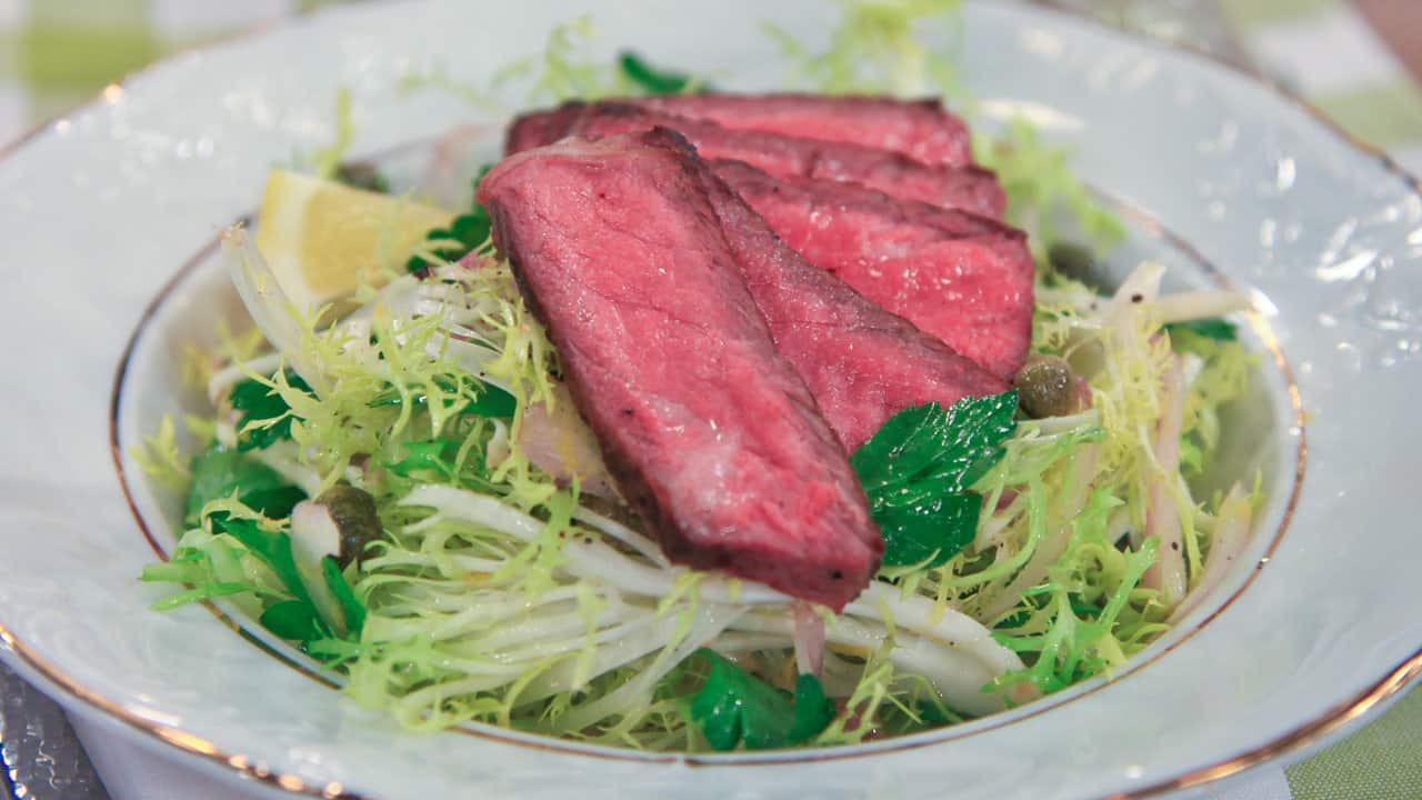 Image of steak with parsley and caper salad