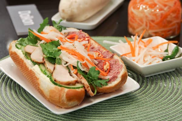 Vietnamese chicken sandwich with pickled carrot and daikon radish.