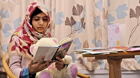 prime-minister-stephen-harper-signs-petition-to-nominate-malala-yousafzai-for-the-nobel-peace-prize-feature1.jpg