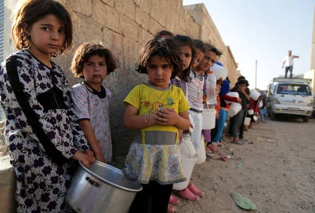 syria-children-getty-food-line-mezar.jpg