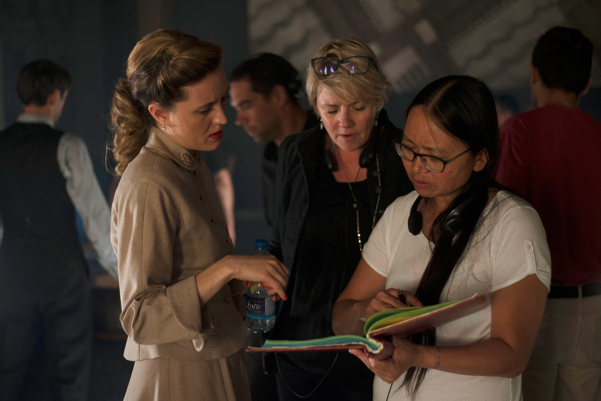 Evelyne Brochu, Director Amanda Tapping and Script Supervisor Winnie Jong look over Aurora's lines on the set of X Company.