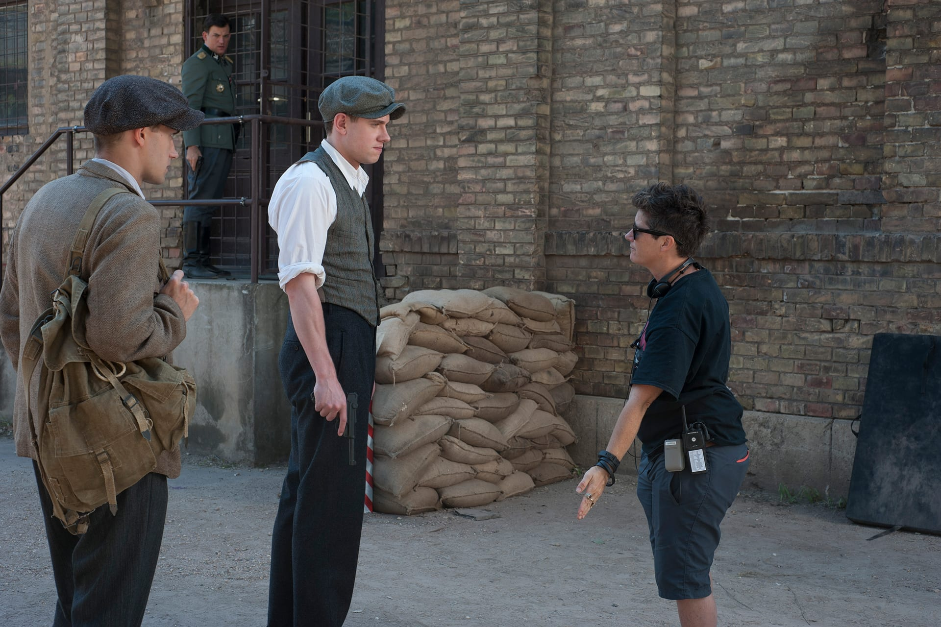 Behind the scenes on the set of X Company Season 3 with 1st AD Sorcha Vasey, Tom Brittney (David), Lewis Rainer (Peter) and Torben Liebrecht (Faber) in the background.