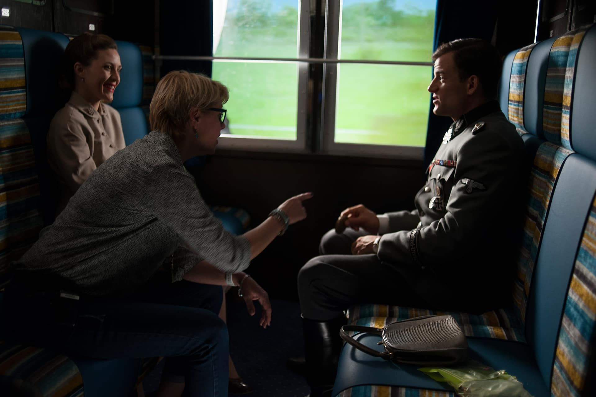 Director Amanda Tapping discusses a scene with actors Torben Liebrecht and Evelyne Brochu.