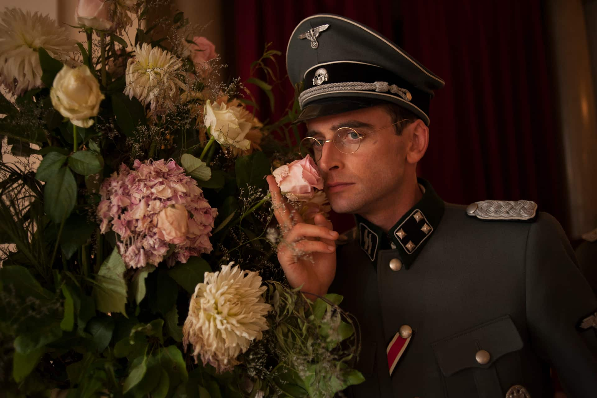 Jack Laskey (Alfred) takes some time to smell the roses on the set of X Company Season 3.