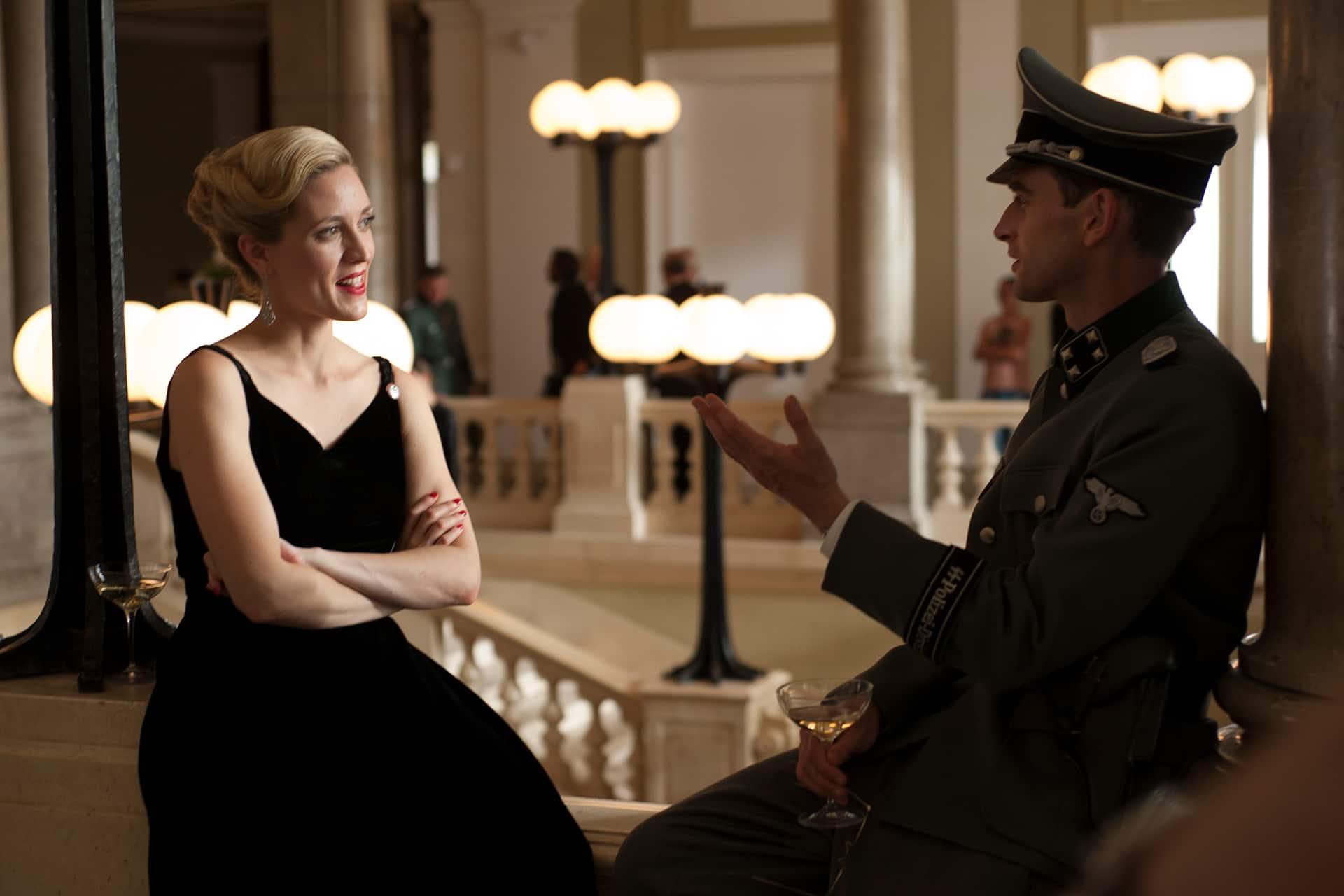 Evelyne Brochu (Aurora) and Jack Laskey (Alfred) take a break on the set of X Company Season 3 shooting in Budapest, Hungary.