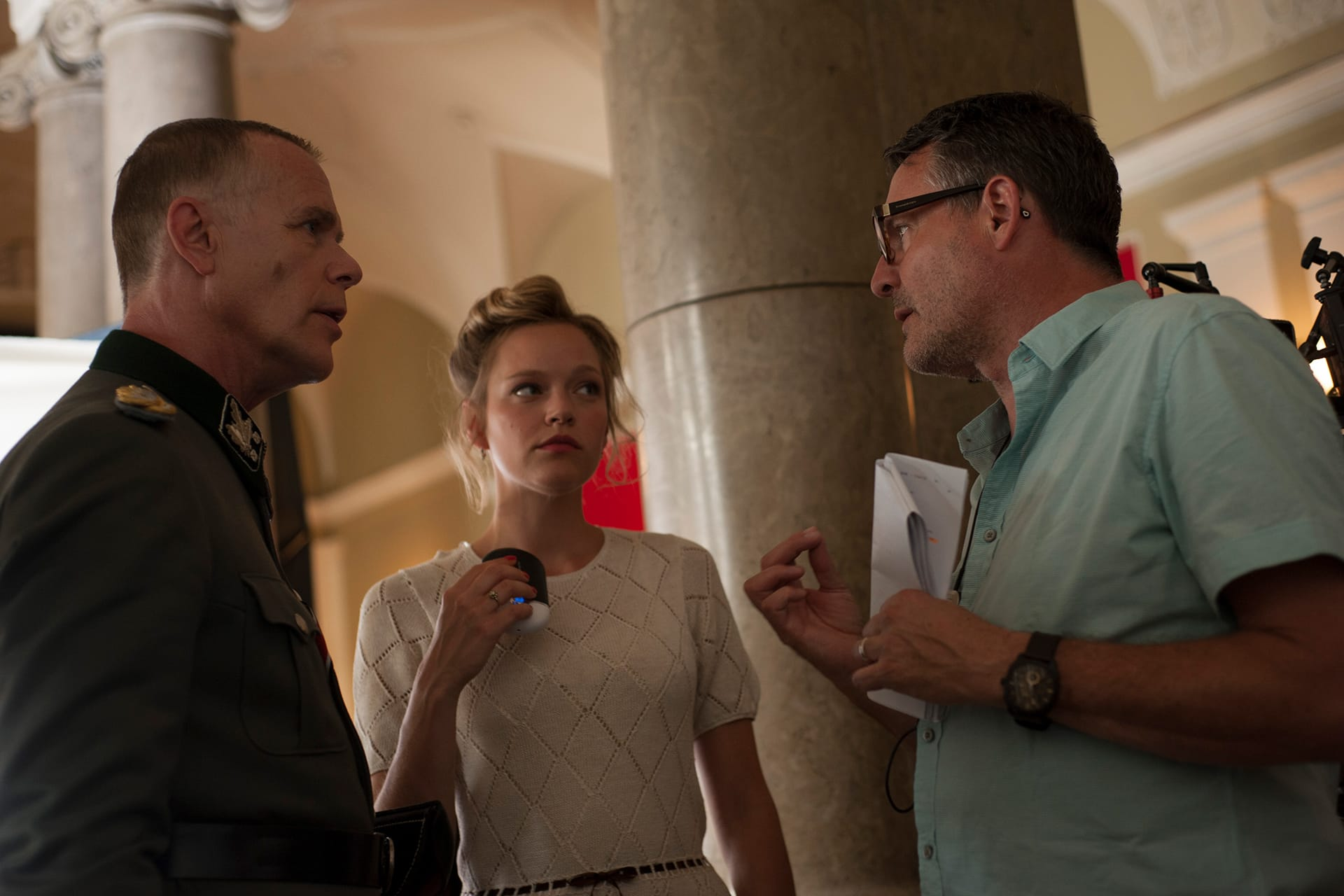 Morten Suurballe (Schmidt) and Livia Matthes (Sabine) with Director Grant Harvey on the set of X Company Season 3.