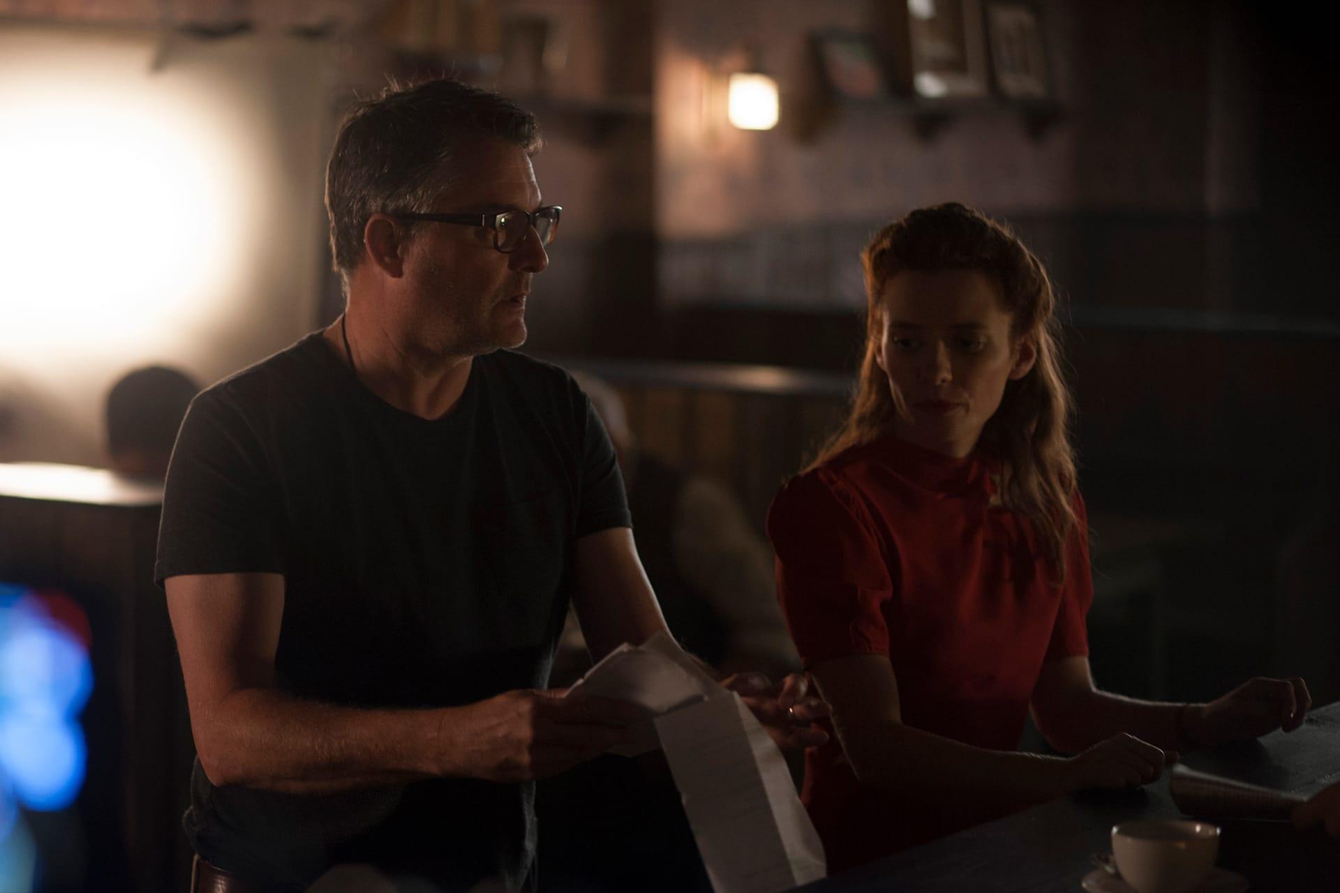 Director Grant Harvey with Lara Jean Chorostecki (Krystina) on the set of X Company Season 3.