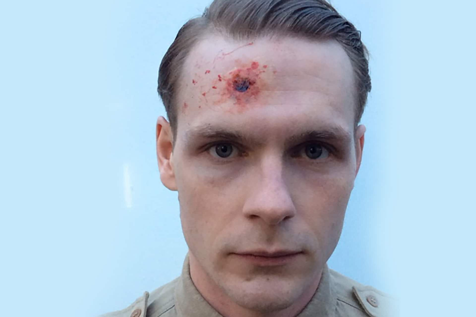 A background performer in special effects makeup as part of the show's Dieppe sequence.